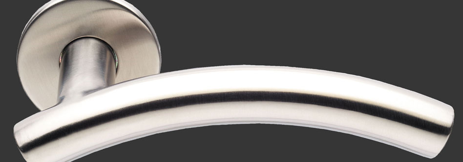 Arched lever handle on rose